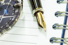 Fountain pen on blank notepad and watch Royalty Free Stock Photography