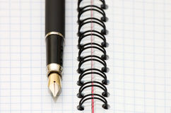 Fountain Pen and blank spiral bound notepad Stock Photos