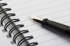 Fountain Pen and blank spiral bound notepad Stock Images