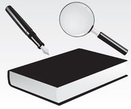 Fountain pen, book and magnifying glass Stock Photo
