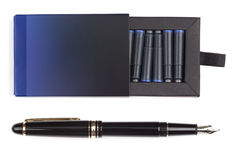 Fountain pen and box of cartridges Royalty Free Stock Image