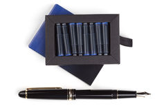 Fountain pen and box of cartridges Royalty Free Stock Photography
