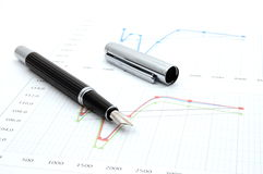 Fountain pen on business chart Stock Photos