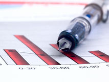 Fountain pen and  Business charts Stock Photos