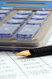 Fountain pen and calculator Royalty Free Stock Photography