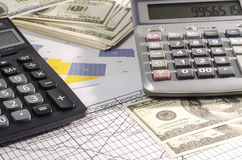 Fountain pen and calculator on the financial graph. Royalty Free Stock Photos