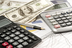 Fountain pen and calculator on the financial graph. Royalty Free Stock Photography