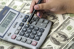 Fountain pen and calculator on the financial graph. Stock Photo