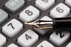 Fountain pen and calculator Royalty Free Stock Images