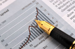 Fountain pen and chart. A fountain pen putting on a paper, with bar and trend line chart Stock Image