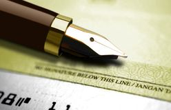 Fountain pen and cheque Royalty Free Stock Images