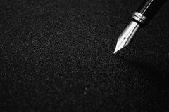 Fountain Pen with clipping path on black textured background for signature concept Royalty Free Stock Photo