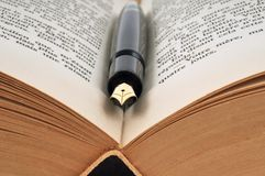 Fountain pen placed on a book royalty free stock images