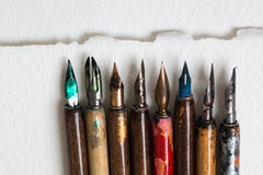Fountain pen collection. Calligraphic accessories, macro up view soft focus. Royalty Free Stock Image