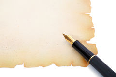 Fountain pen on decorative paper Royalty Free Stock Photos