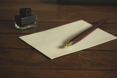 Fountain pen on a desk Royalty Free Stock Images