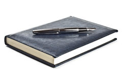 Fountain pen on diary Stock Images
