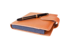 Fountain pen on diary isolated Royalty Free Stock Photos