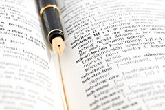 Fountain pen and dictionary book Stock Images