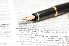Fountain pen and dictionary book Stock Photography
