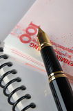 Fountain pen, document and bills Stock Images