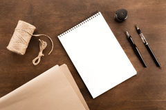 Fountain pen, drawing album and water brush pen on wooden table Stock Photos