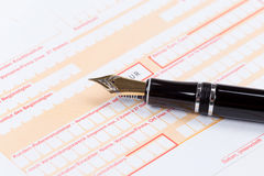Fountain Pen on empty Remittance slip Royalty Free Stock Image