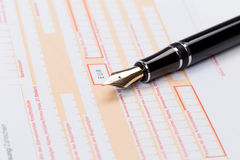 Fountain Pen on empty Remittance slip Stock Images