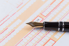 Fountain Pen on empty Remittance slip Stock Photo