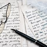Fountain pen and eyeglasses Royalty Free Stock Image