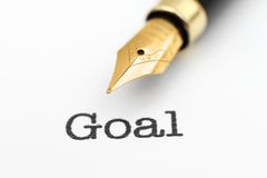 Fountain pen on goal text Royalty Free Stock Images