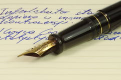 Fountain pen. With gold, ornate nib on a notebook Stock Photo