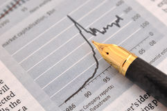 Fountain pen and graph. A fountain pen putting on a paper, with business graph chart, data and description Stock Image
