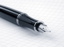 Fountain pen on graph paper Stock Photography