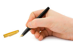 Fountain pen in hand Stock Image