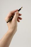 Fountain Pen in Hand. Black Fountain Pen in Hand Stock Images
