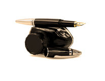 Fountain pen and ink. Fountain pen and black ink bottle isolated on white background sepia filter Stock Image