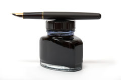Fountain pen on the ink bottle Stock Images