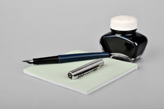 Fountain pen with ink bottle and paper Stock Photography