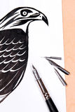 Fountain pen with ink drawing hawk. Stock Photography