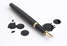 Fountain pen and ink spots. On white background stock image
