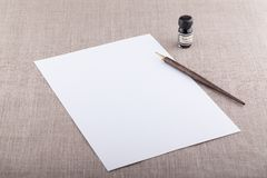 Fountain pen and ink with white sheet. Horizontal Stock Photography
