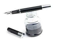 Fountain pen and inkwell Stock Photos