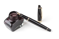 Fountain pen and inkwell. Over white background Stock Photography
