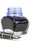 Fountain pen and inkwell Stock Images