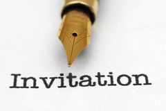 Fountain pen on invitation text Royalty Free Stock Image
