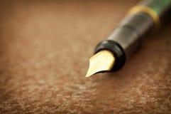 Fountain pen on iron royalty free stock image