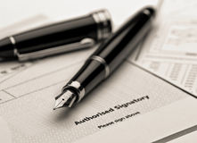 Fountain pen on legal document. Royalty Free Stock Photos