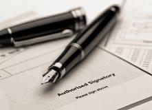 Fountain pen on legal document. Royalty Free Stock Photos