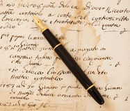 Fountain pen on letter. Fountain pen on an antique  letter Stock Images